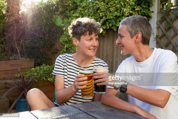 Cheers! - Couple enjoying a cool beer in their garden