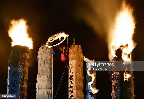 Cheers erupt each time a huge torch is burned down during a festival known as Taimatsu Akashi on November 12 2016 in Sukagawa Fukushima Japan Bamboo...