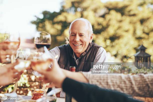 cheers to family and food - senior lunch stock photos and pictures