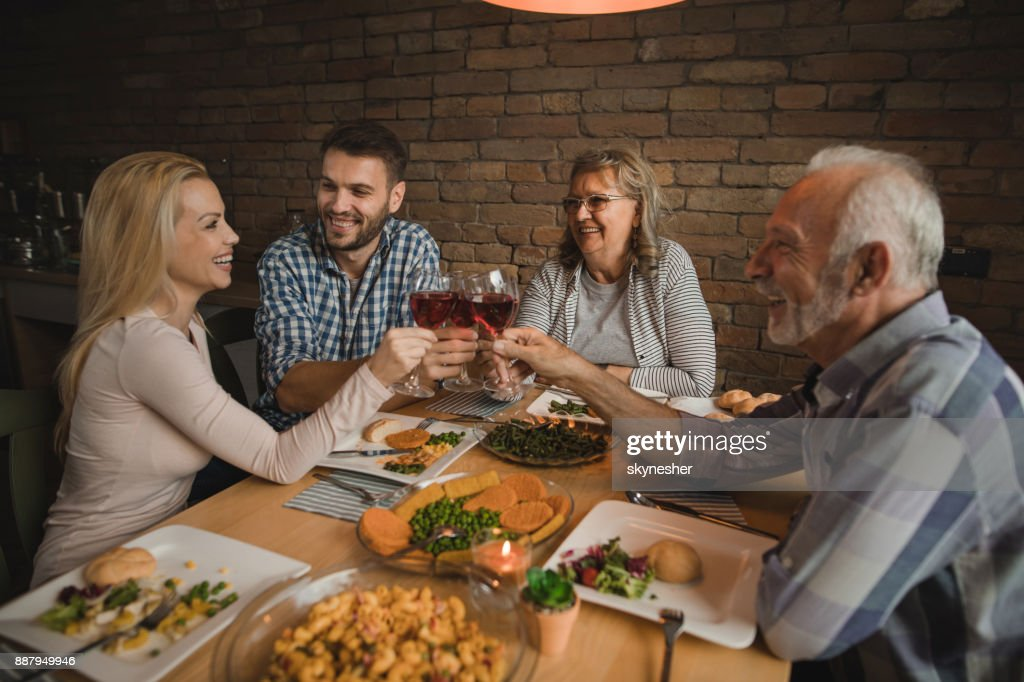 Cheers to lovely meal with family! : Stock Photo