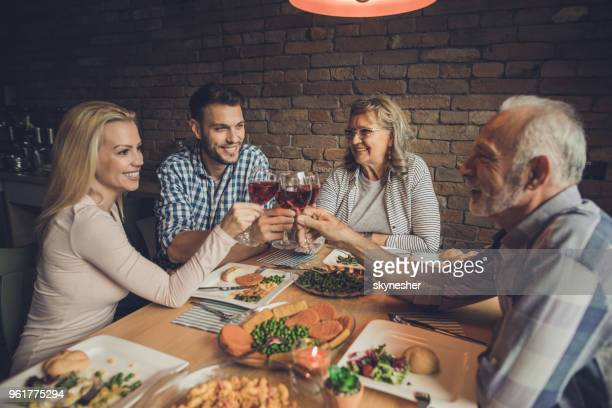 cheers to lovely meal with family! - mother in law stock pictures, royalty-free photos & images