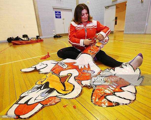 Cheersquad member gets their lucky duck mascot ready for the banner during the creation of the Sydney Swans AFL banner at Glenroy College on...