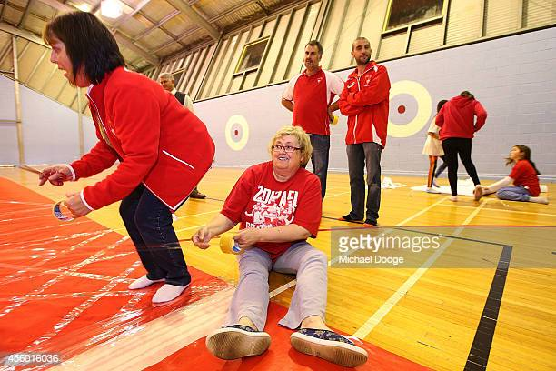 Cheersquad members hold pieces of tape to applied during the creation of the Sydney Swans AFL banner at Glenroy College on September 24 2014 in...