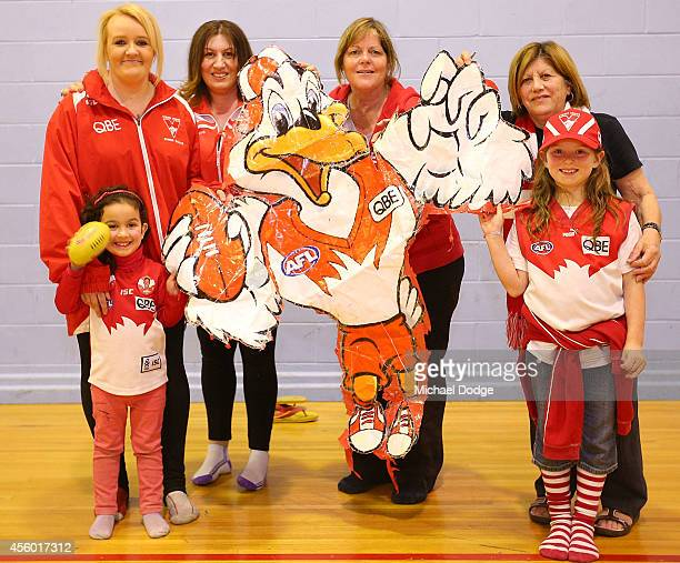 Cheersquad members pose with their lucky duck mascot that they have applied to every grand final banner since 2005 during the creation of the Sydney...
