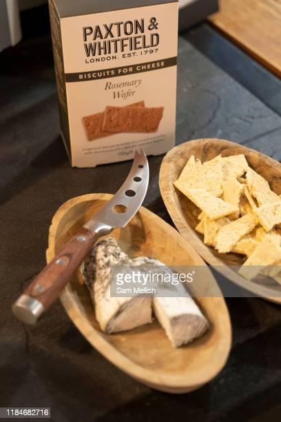 A cheese and biscuit tasting display at Paxton Whitfield shop on Jermyn Street on the 26th September 2019 in London in the United Kingdom