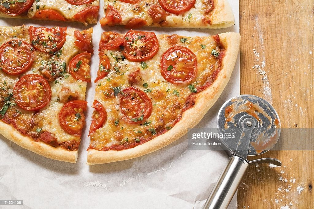 Cheese and tomato pizza with oregano (quartered) : Stock Photo