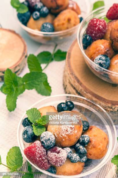 Cheese balls with raspberry, blackberry and blueberry and mint