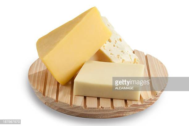 cheese blocks on a cutting board - cheddar cheese stock photos and pictures
