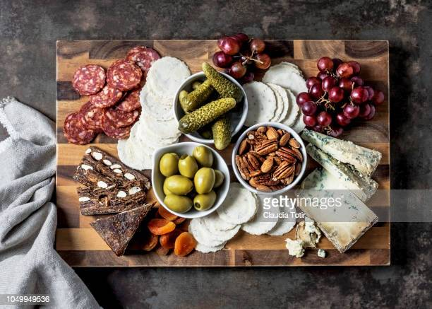 cheese board - antipasto stock pictures, royalty-free photos & images