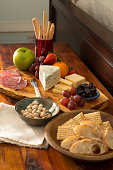 cheese board with fruit nuts meat