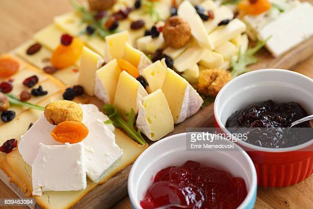 Cheese board with various types cheese and jam