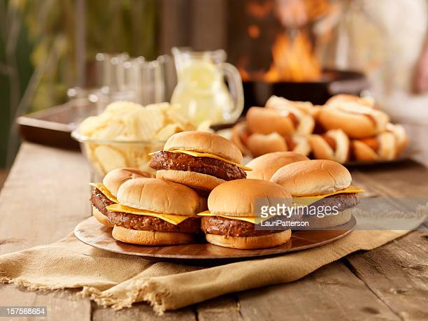 bbq cheese burgers and hot dogs - hamburger stock pictures, royalty-free photos & images