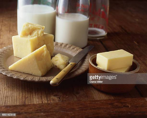 Cheese, butter and milk bottles on wooden table