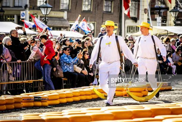 Cheese carriers walk during the opening of the cheese season of the largest and oldest cheese market on the Waagplein in Alkmaar on March 29 2019 /...
