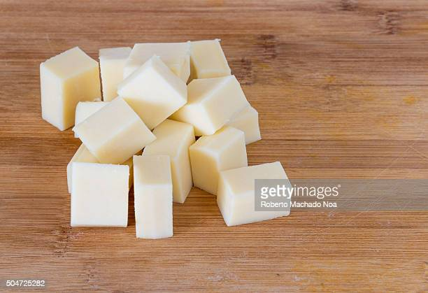 Cheese cubes Diced Cheese closeup shot on wooden background