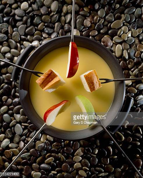 Cheese fondue with apples and bread