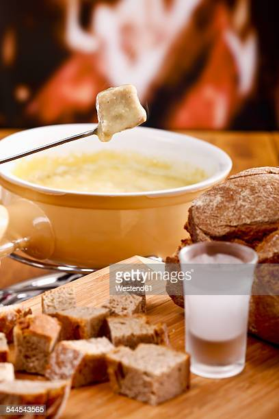 Cheese fondue with bread and schnapps