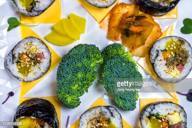 cheese gimbap and kimchee, broccoli - jong heung lee stock pictures, royalty-free photos & images