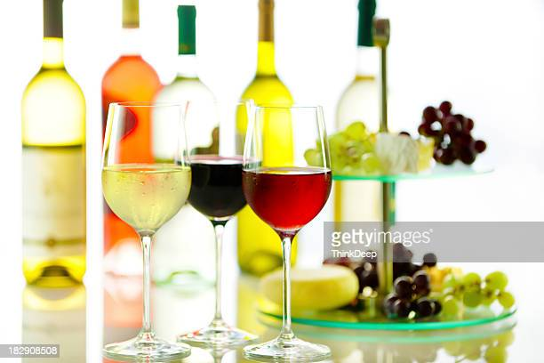 Cheese, grapes and 3 glasses of wine in different colors