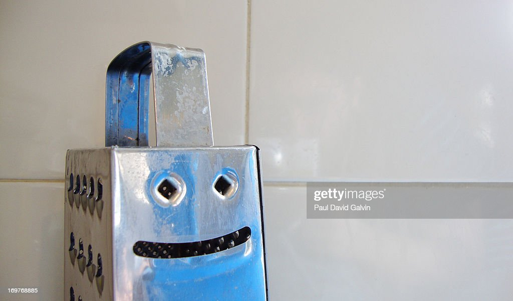 Cheese Grater Smiling : Stock Photo