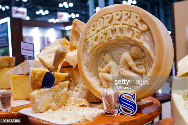 Cheese is offered for attendees during The Summer Fancy Food Show at the Javits Center in the borough of Manhattan on July 02 2018 in New York The...