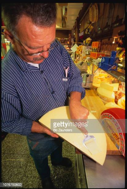 Cheese Merchant Slicing Cheese