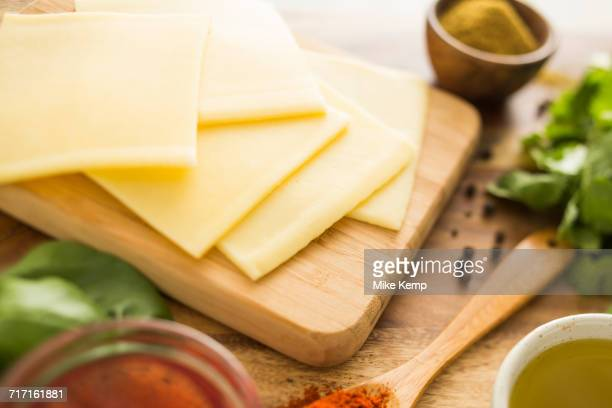 cheese on cutting board - slice stock pictures, royalty-free photos & images