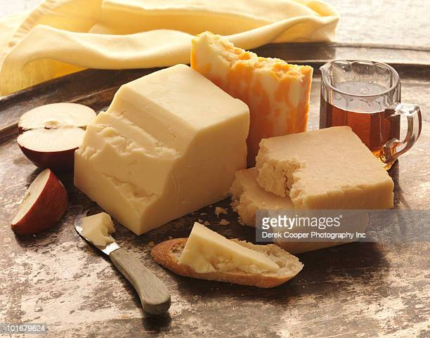 cheese - cheddar cheese stock photos and pictures