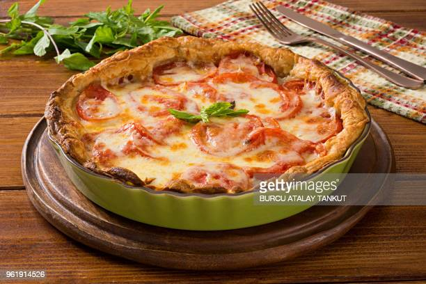 cheese pie with tomatoes - savory pie stock photos and pictures