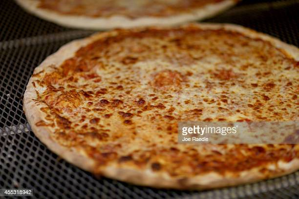 A cheese pizza is seen at Miami's Best Pizza restaurant on September 12 2014 in Coral Gables Florida Reports indicate that milk futures have risen to...