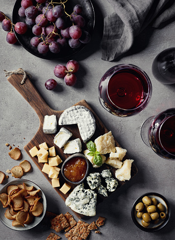 Cheese plate and red wine 996129562