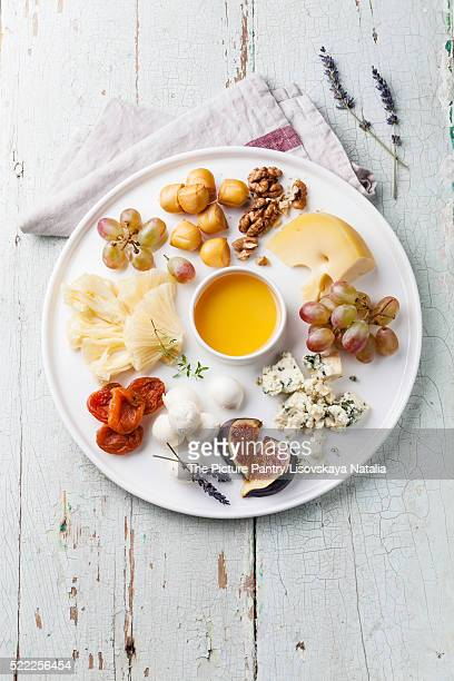 Cheese plate Assortment of various types of cheese and honey on