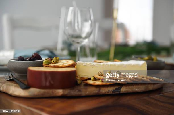 cheese plate on a beautiful christmas table - cracker snack stock photos and pictures