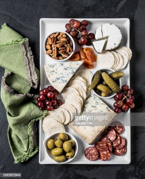 cheese plate - brie stock photos and pictures
