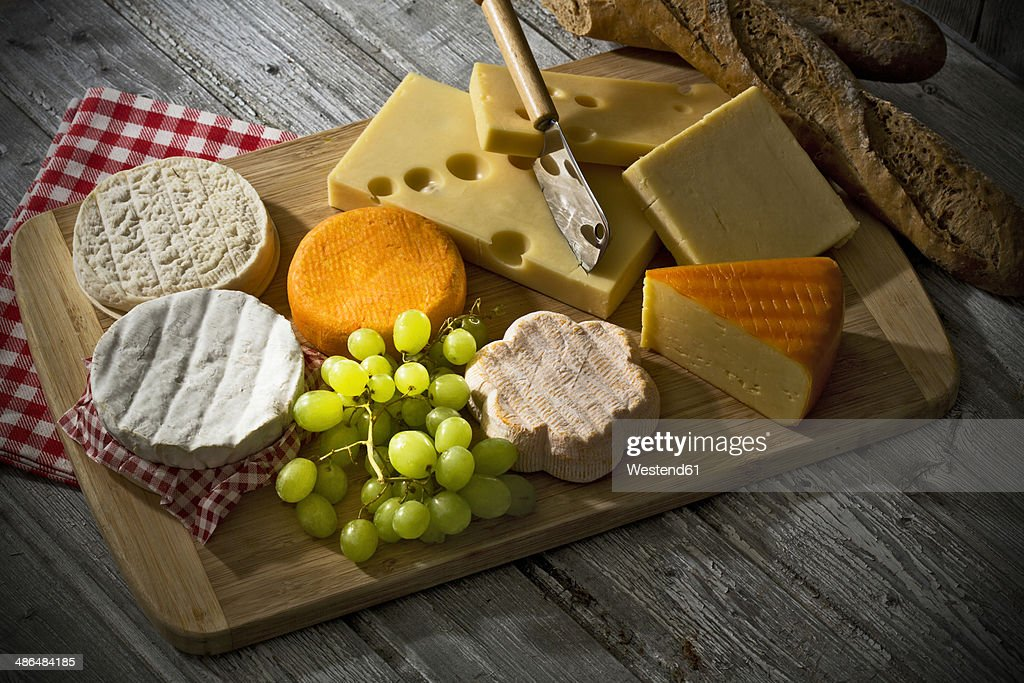 Cheese platter different cheese french cheddar french soft cheese french sheep cheese & Cheese Board Stock Photos and Pictures | Getty Images