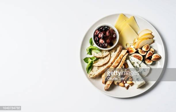 cheese platter - antipasto stock pictures, royalty-free photos & images