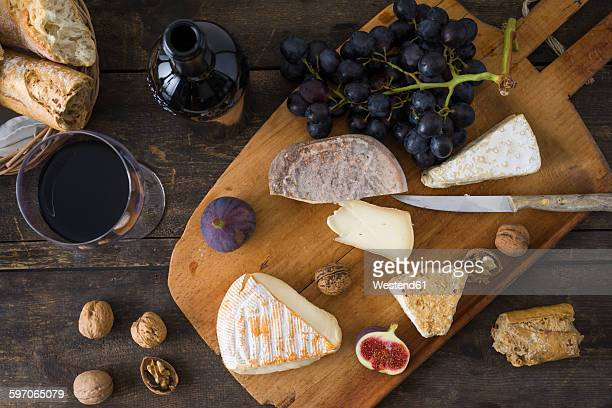 cheese platter with camembert, walnut cheese, gorgonzola and taleggio - french culture stock photos and pictures