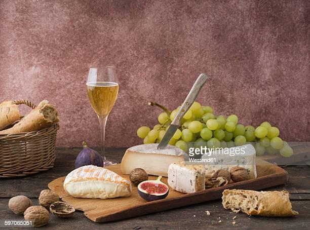 Cheese platter with camembert, walnut cheese, gorgonzola, taleggio and champagne