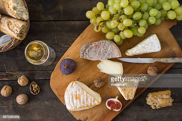 Cheese platter with camembert, walnut cheese, gorgonzola, taleggio and champagne