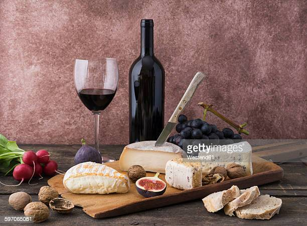 Cheese platter with camembert, walnut cheese, gorgonzola, taleggio and red wine