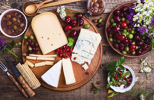 Cheese platter with fresh colorful summer berries - gettyimageskorea