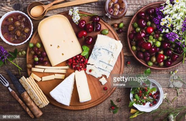 cheese platter with fresh colorful summer berries - spread food stock pictures, royalty-free photos & images