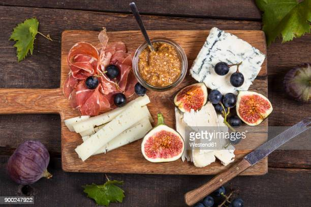 Cheese platter with fruits and fig mustard