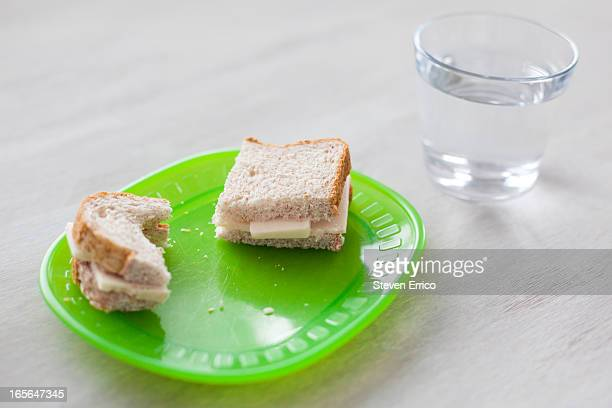 cheese sandwich and glass of water - plastic plate stock photos and pictures