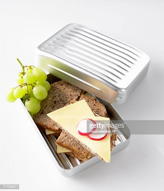 Cheese sandwiches and green grapes in lunch box