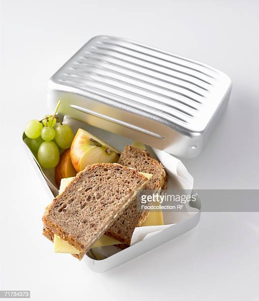 Cheese sandwiches, apple and green grapes in lunch box