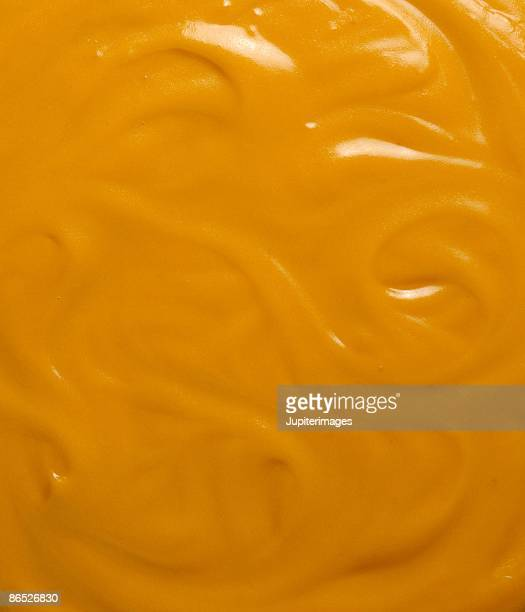 cheese sauce - cheese sauce stock photos and pictures
