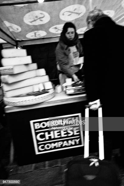 cheese stall outside kings cross station - reality kings stock pictures, royalty-free photos & images