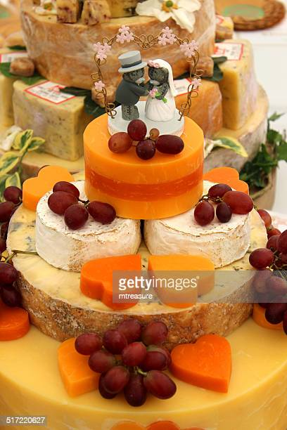 Cheese wedding cake, decorated cheese cake, Cheddar, Red-Leicester, brie, grapes