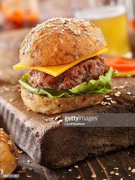 CheeseBurger and a Beer on a Rustic Wood Cutting Board